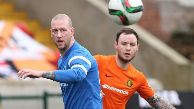 Action from Ballinamallard against Carrick Rangers