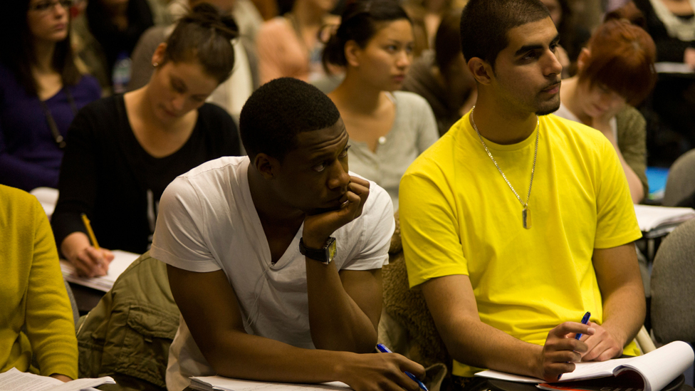Two students in lecture hall