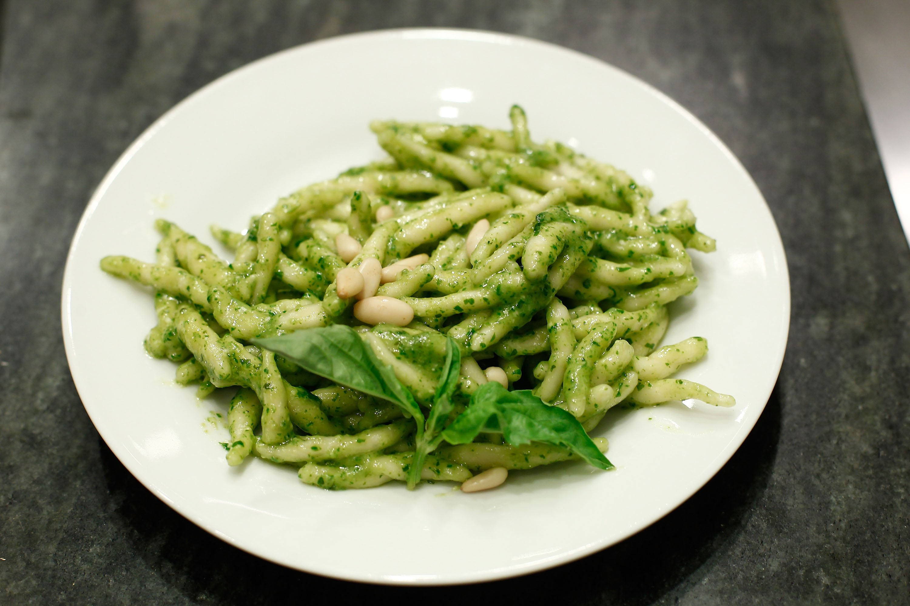 A plate of pasta with pesto