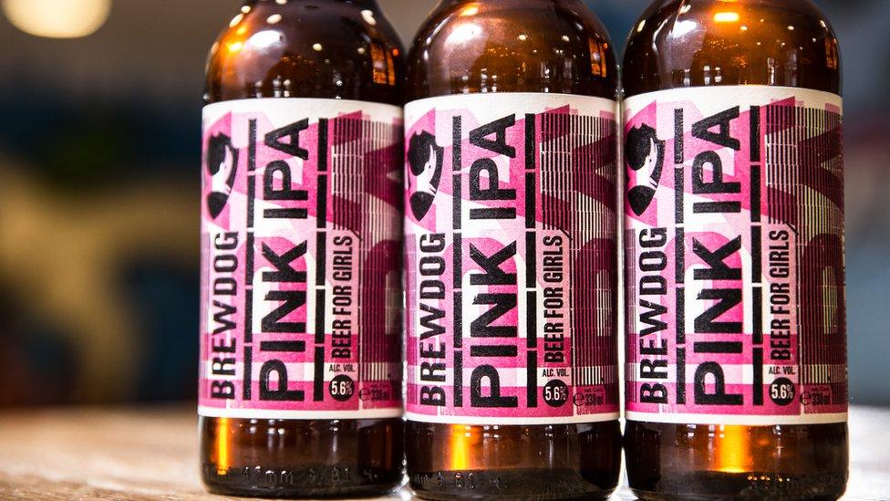 Three bottles of Pink IPA beer