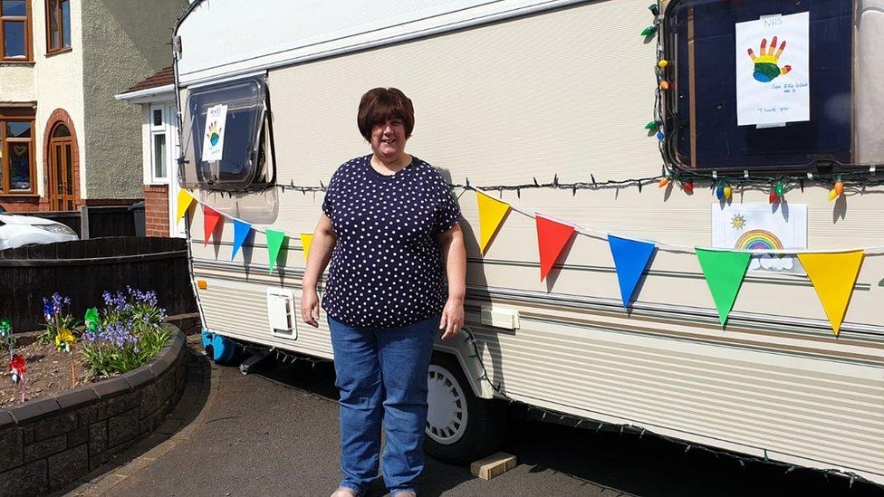 Sarah Link in front of her caravan