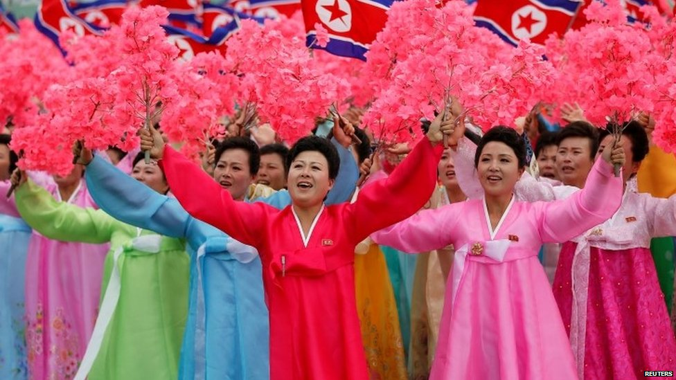 Women react as they see North Korean leader Kim Jong-un