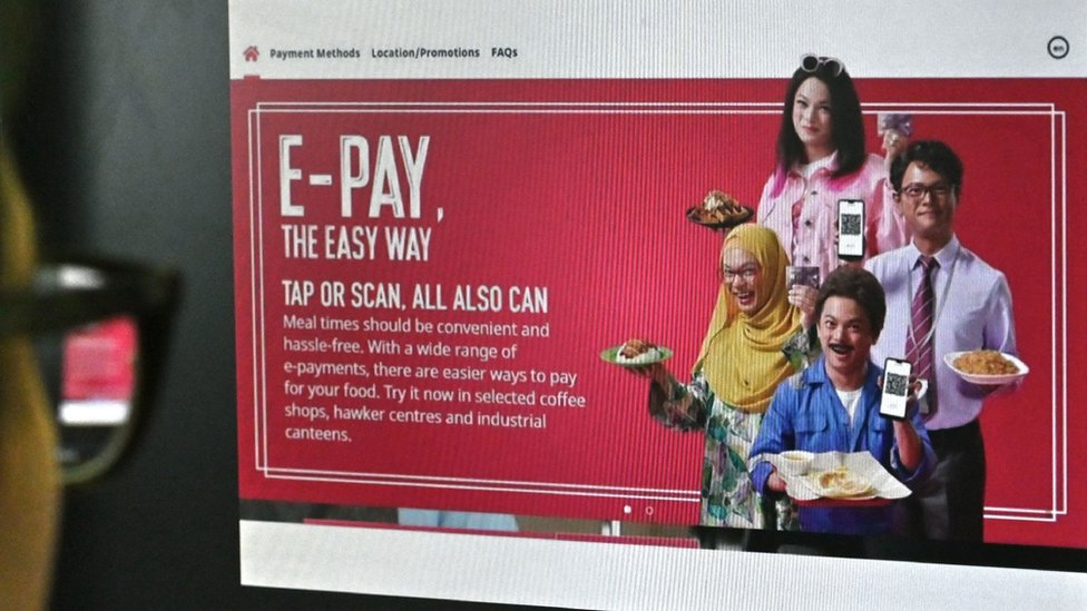 The Nets e-pay advert showing actor Dennis Chew in dark make up, dressed as both an Indian man and a Malaysian woman in a hijab