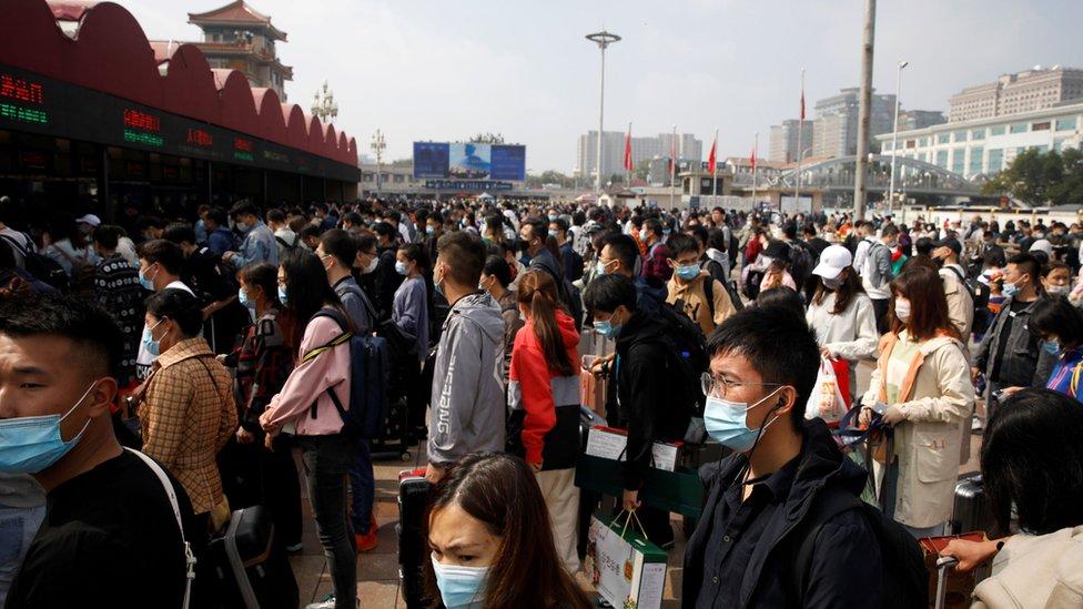 Crowds of people outside Beijing Railway station