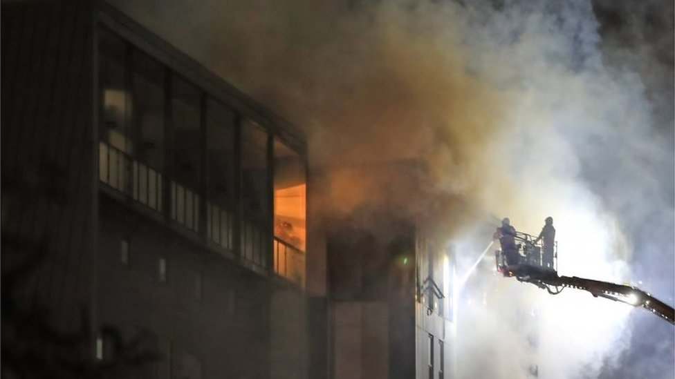 Fire fighters at the scene after a fire on the top floors of a building on Bradshawgate in Bolton.