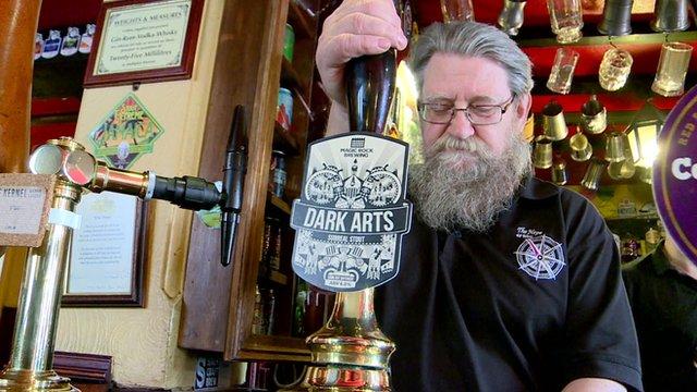 Man pulling a pint in a pub