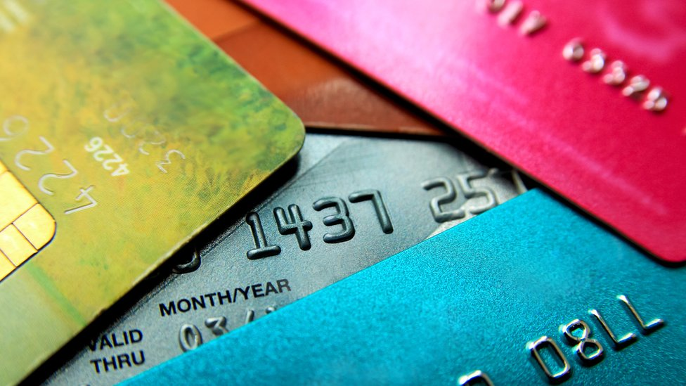 Stack of multicoloured credit cards.