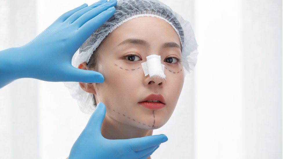 young woman rhinoplasty stock photo