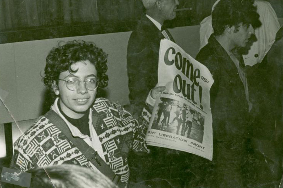 Martha Shelley holding Come Out!