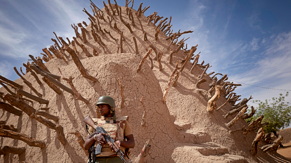 A soldier of the Malian army patrols the archaeological site of the Tomb of Askia in Gao - 10 March 2020