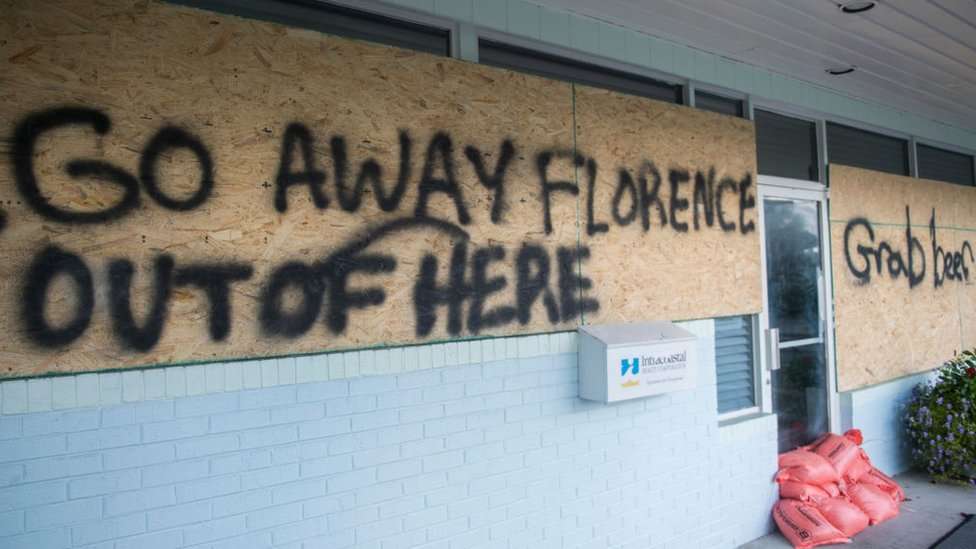 """a sign tells the hurricane to """"go away"""""""