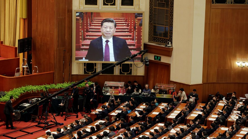 China's President Xi Jinping seen on a screen as he attends the opening session of the Chinese People's Political Consultative Conference (CPPCC) at the Great Hall of the People in Beijing, China, 3 March 2017