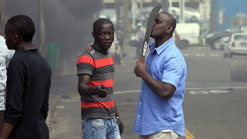 An armed man in South Africa during anti-foreigner violence