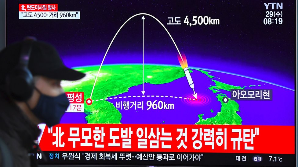A television screen in Seoul, South Korea, shows a graphic of a North Korean inter-continental missile test in November 2017