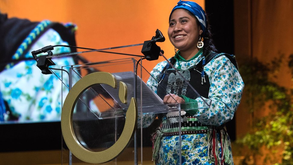 Belén Curamil Canio accepts the Goldman prize award on behalf of her father, Alberto
