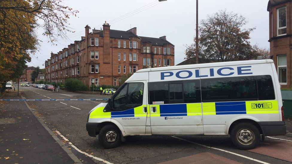 Man shot in Glasgow flat by masked attackers