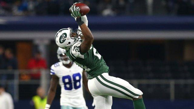 New York Jets Darrelle Revis makes an interception against the Dallas Cowboys