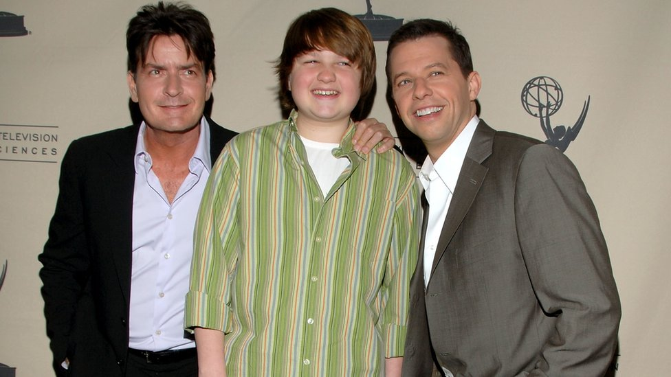 Charlie Sheen at the height of the show's success with co-stars Angus T. Jones and Jon Cryer