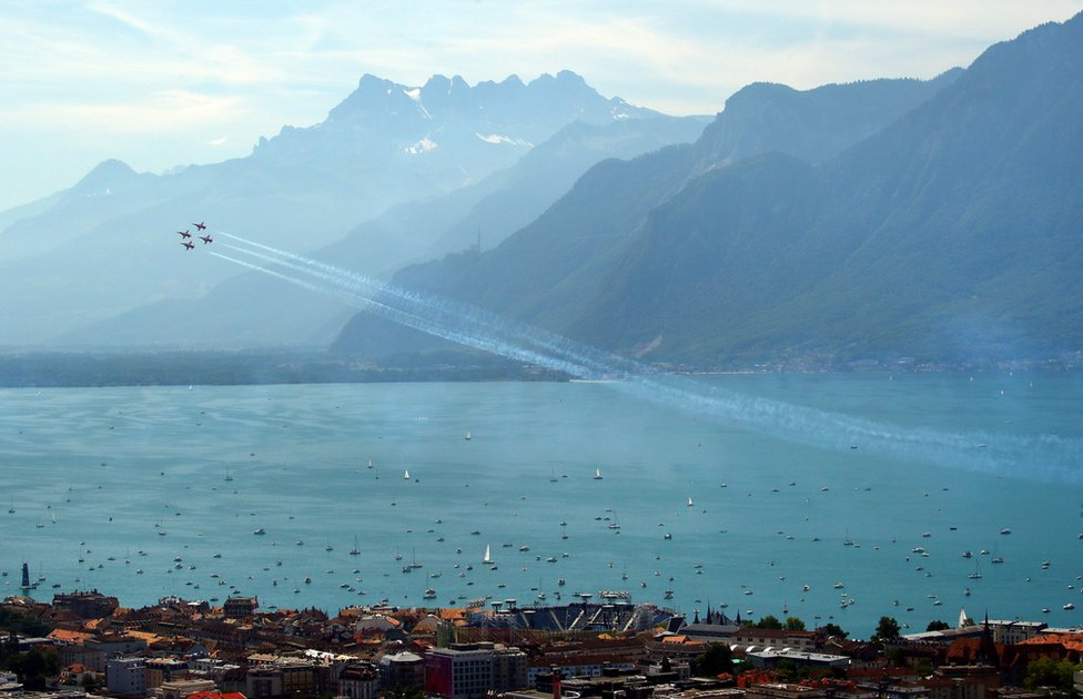 Fighter aircraft F-5 Tigers perform a show above Lake Leman in Vevey, Switzerland