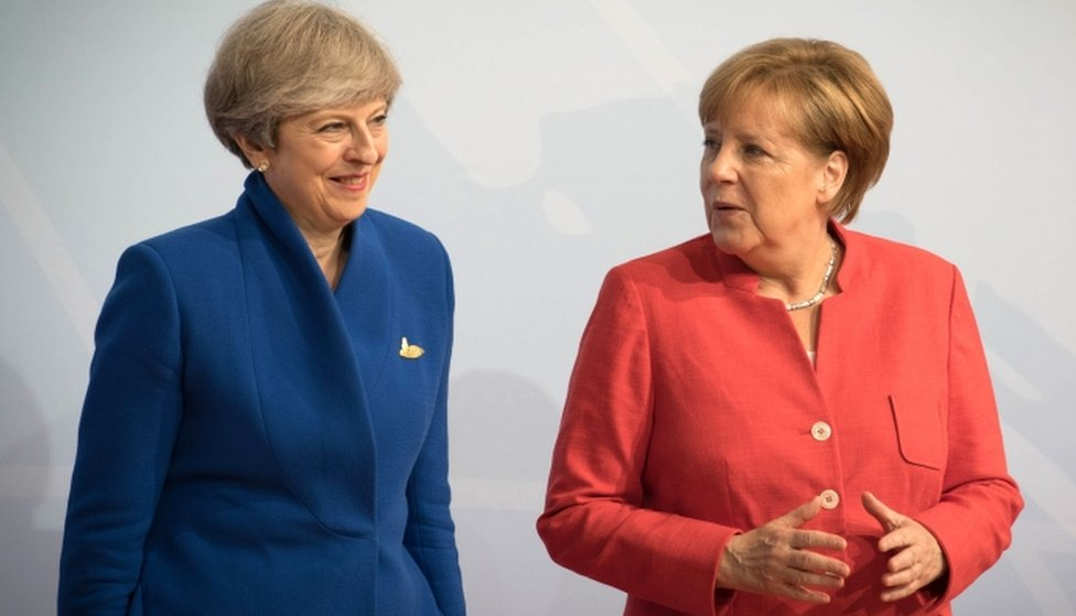 Prime Minister Theresa May and German Chancellor Angela Merkel attend the G20 summit on 7 July, 2017 in Hamburg, Germany