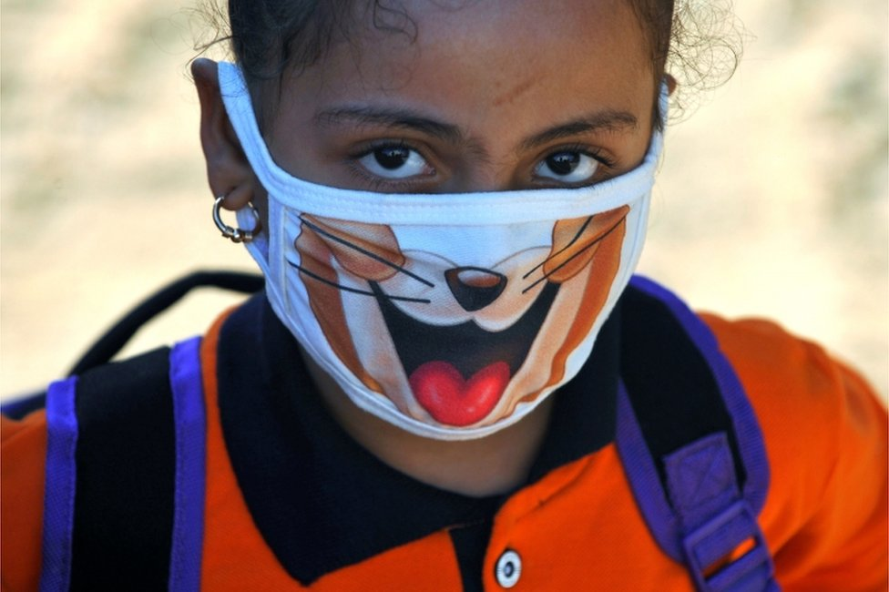 """A student wearing a protective face mask attends the first day""""s class at El Safa school, following months of closure due to the coronavirus disease (COVID-19) outbreak in the Giza suburb of Awsim, Egypt October 18, 2020."""