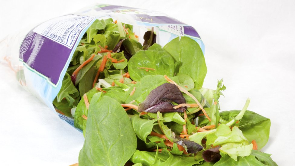 A stock image of a bag of salad