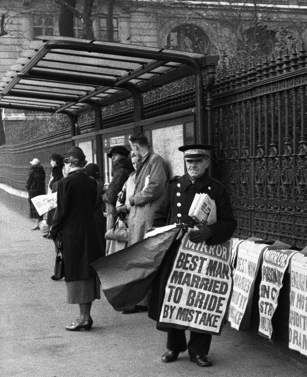 Newspaper seller on Horseguards Avenue, London, 1937