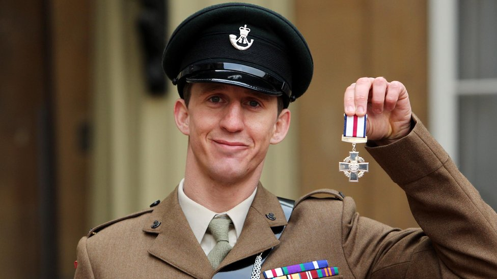 Deacon Cutterham with his Conspicuous Gallantry Cross at Buckingham Palace