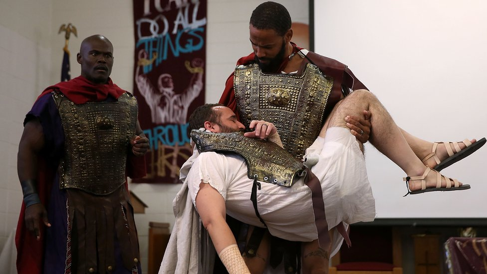 San Quentin State Prison inmates LeMar Harrison (C) and Carlos Flores (R) rperform in a production of Shakespeare's Julius Ceaser at San Quentin State Prison on May 15, 2015 in San Quentin, California.