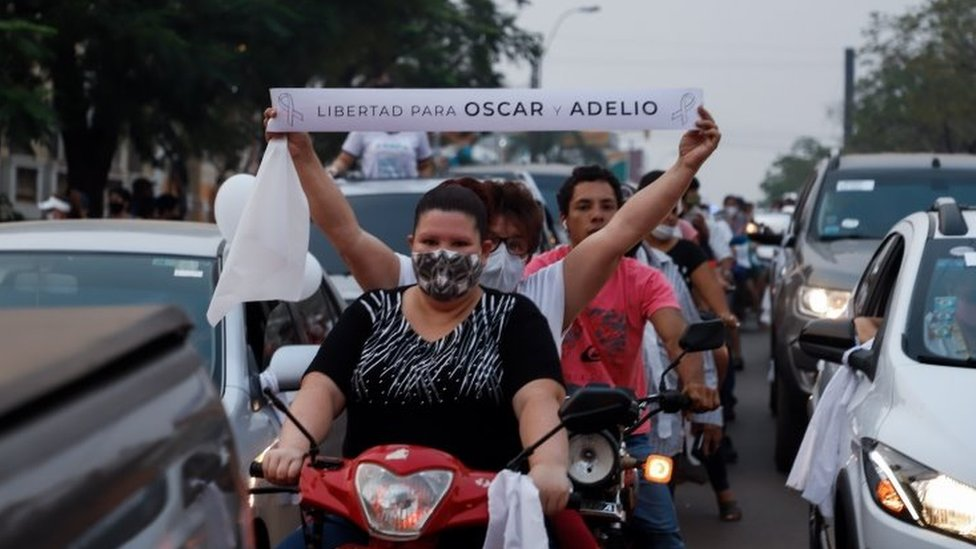 People participate in a demonstration in Concepcion, Paraguay, 13 September 2020.