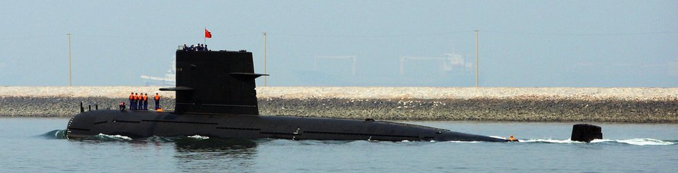 A Chinese navy submarine leaves Qingdao Port on 22 April 2009.