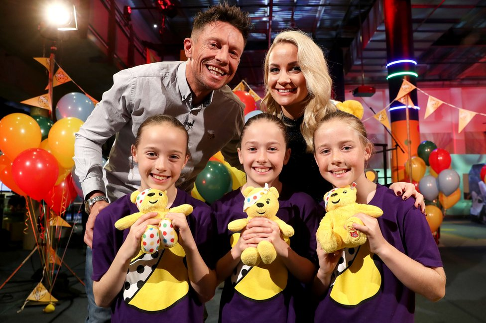 Triplets Armani, Saffarah and Tiara with Children in Need presenters Stephen Clements and Holly Hamilton