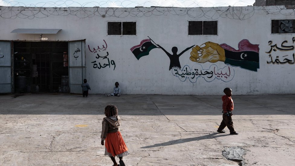 Migrant children walk outside a detention centre in Libya on 30 January 2017