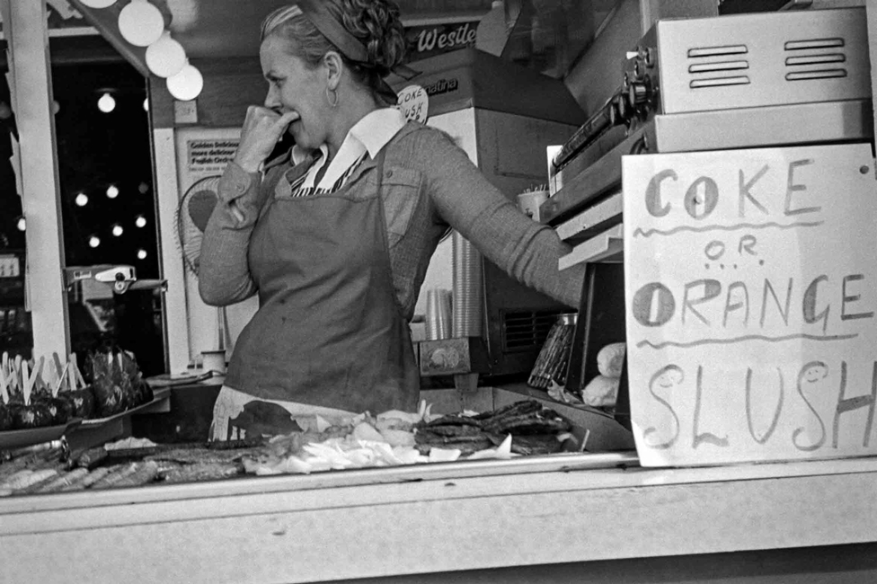A woman at a refreshment kiosk in Rhyl