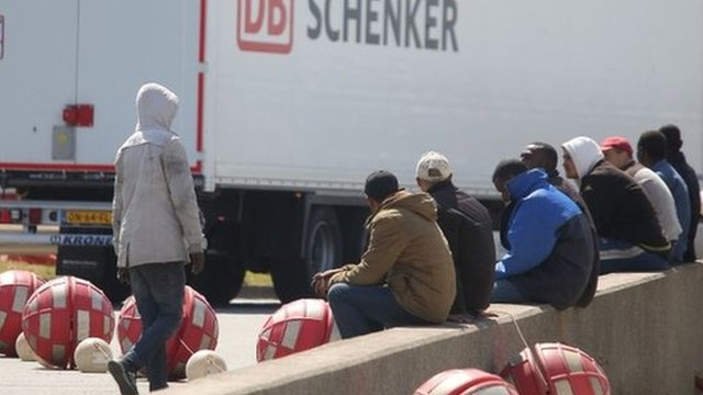 Migrants on the main road into Calais ferry port where some have been trying to board UK bound lorries.
