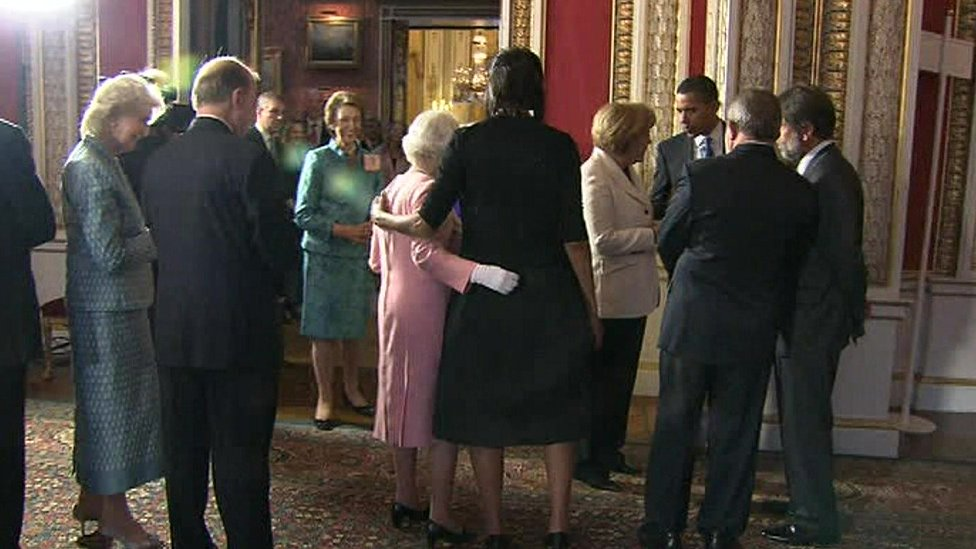 Queen and Michelle Obama with their arms around each other