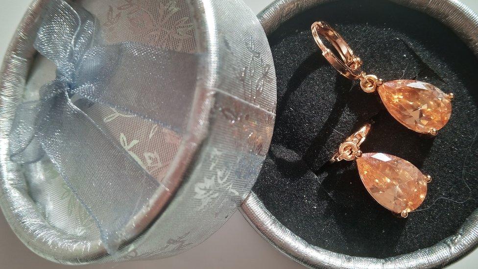 $7 earrings.