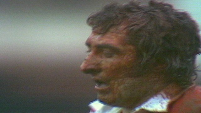 Gareth Edwards' famously muddy face after scoring against Scotland in 1972