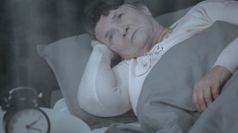 Elderly woman in bed suffering with insomnia