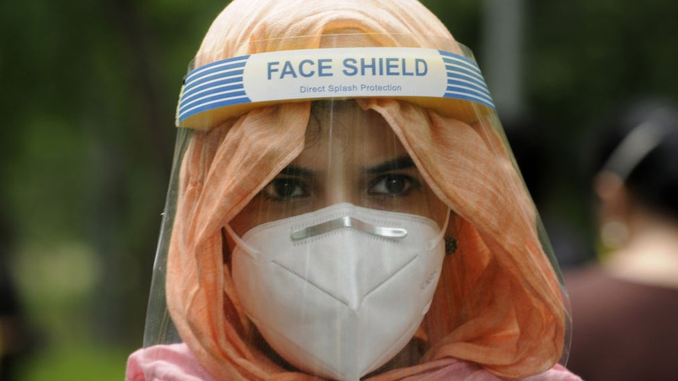 A student wears a face shield while appearing for a B.Ed entrance exam.