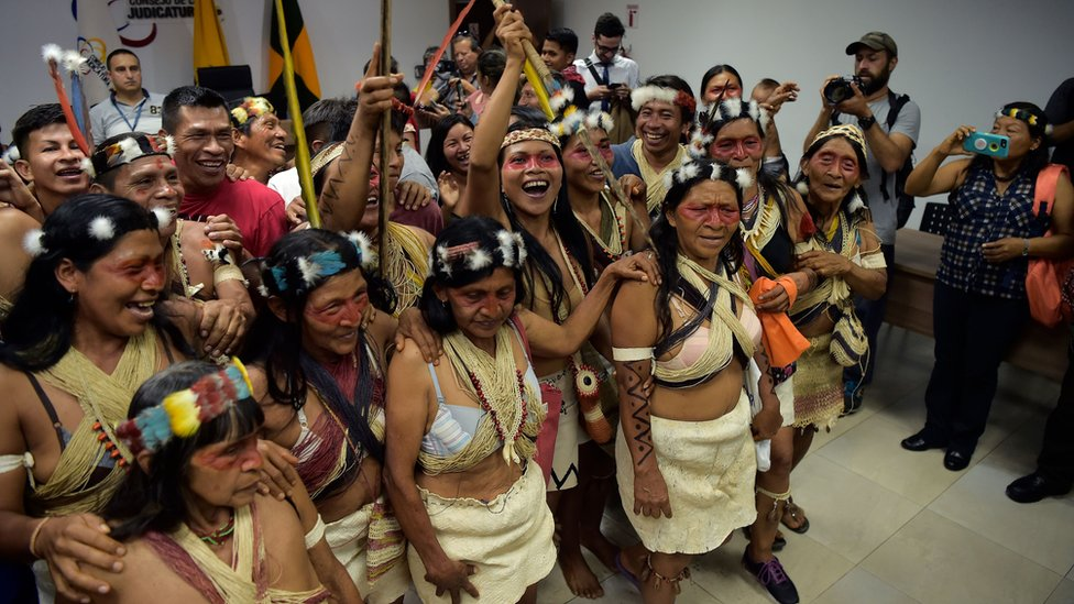 Waorani indigenous people celebrate after a court ruled in their favour on the tribe's legal challenge to the government's land selloff, at the end of the protection action hearing in Puyo, Ecuador, on April 26, 2019.
