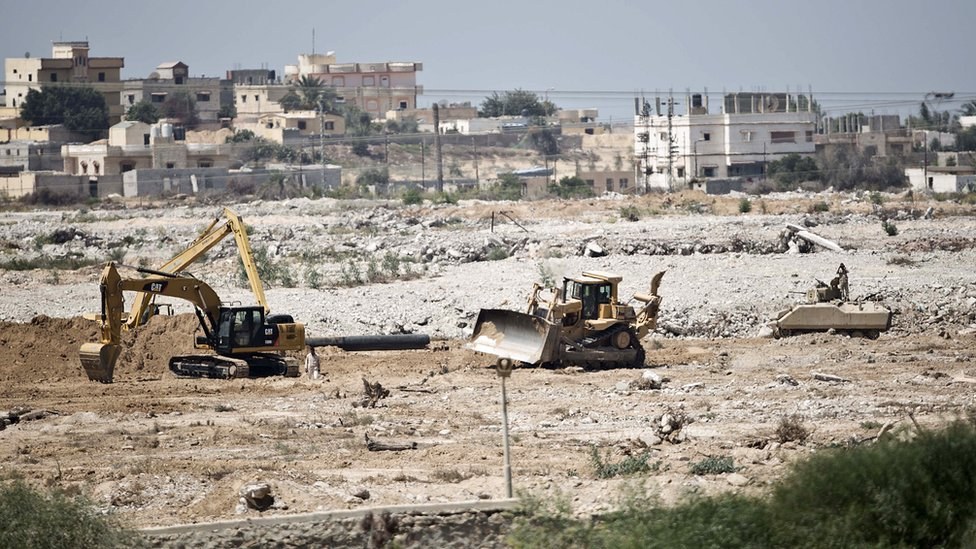 A picture taken from the southern Gaza Strip shows diggers used by the Egyptian army working on the border between Egypt and the Palestinian territory on September 1, 2015.