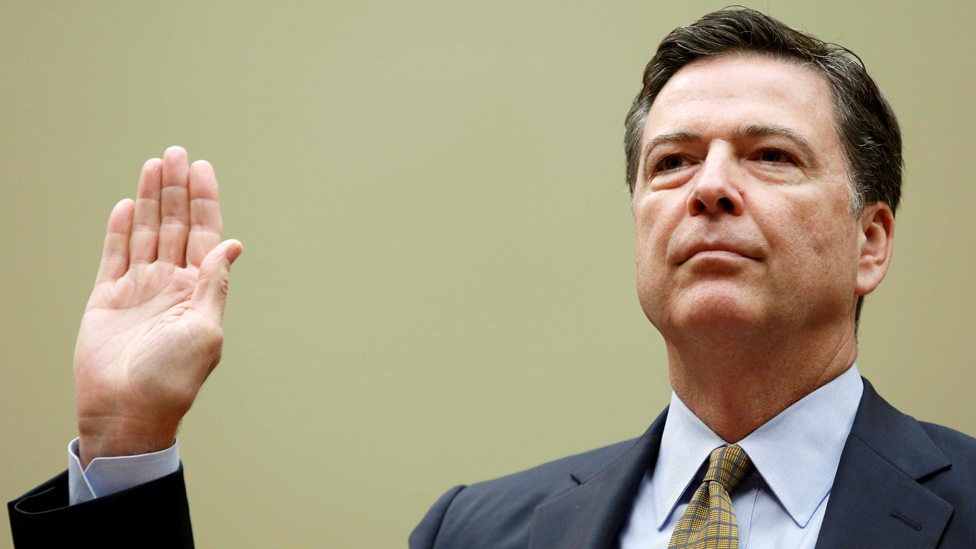 """FBI Director James Comey is sworn in before testifying at a House Oversight and Government Reform Committee on the """"Oversight of the State Department"""" in Washington U.S. on July 7, 2016"""