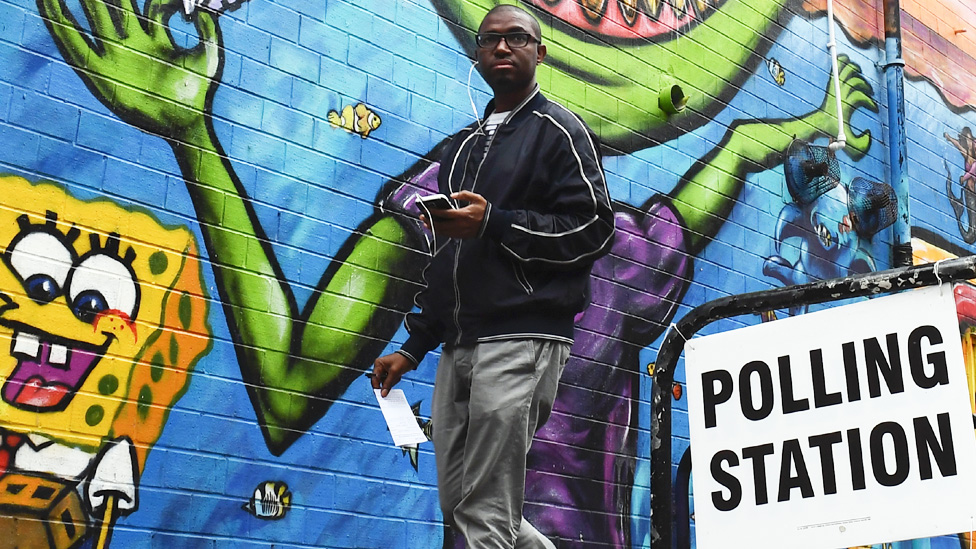 Young man at a polling station