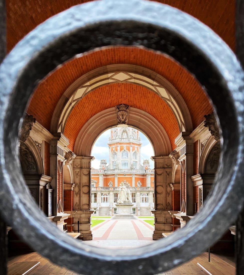 A building seen through a gate