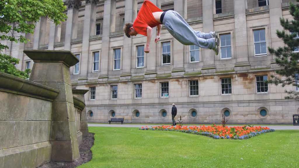 Man mid-jump in Liverpool.