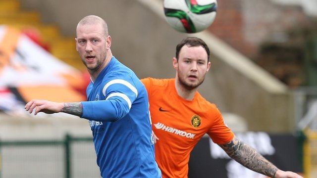 Match action from Carrick Rangers against Ballinamallard United at Solitude