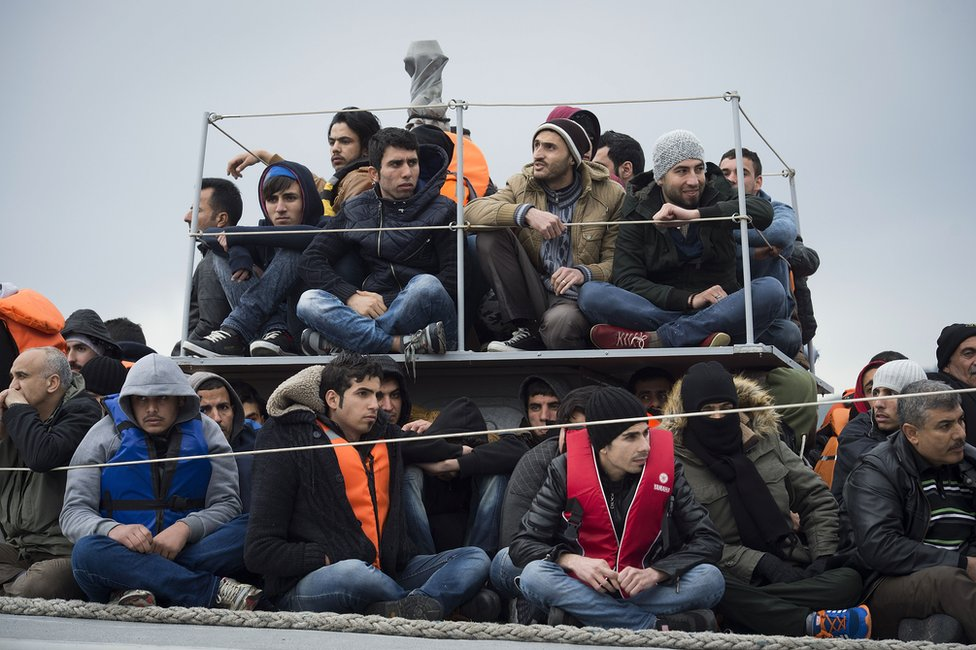 Migrants disembark at the port of Mytelene, Greece, 9 March