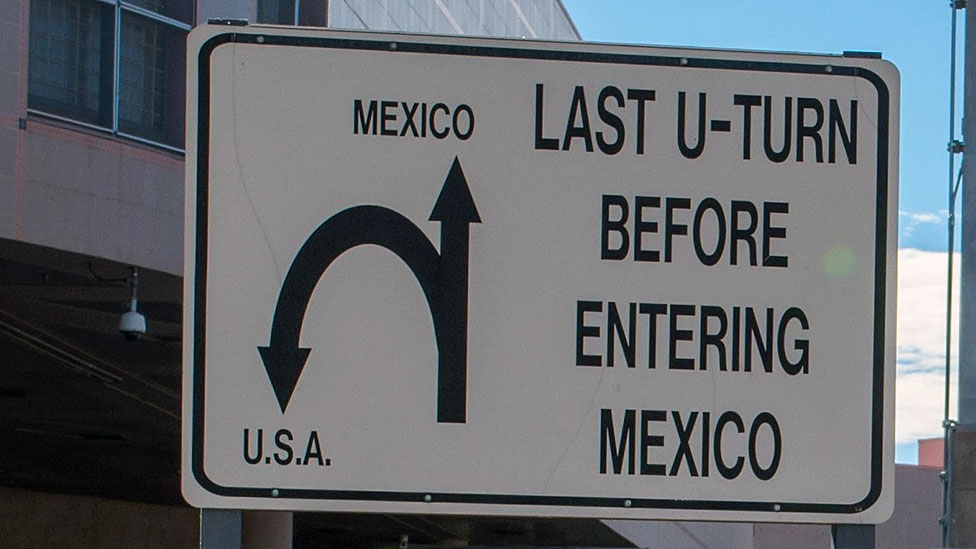 """""""Last u-turn before entering Mexico,"""" says this sign from the border city."""
