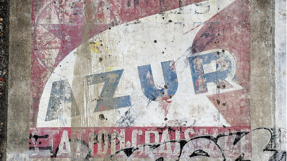 Fading painted ad in France
